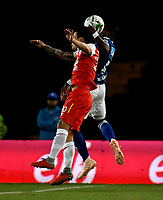 BOGOTÁ - COLOMBIA, 15-01-2019: Luis Seijas (Izq.) jugador de Independiente Santa Fe salta a disputar el balón con Felipe Román (Der.) jugador de Millonarios, durante partido entre Independiente Santa Fe y Millonarios, por el Torneo Fox Sports 2019, jugado en el estadio Nemesio Camacho El Campin de la ciudad de Bogotá. / Luis Seijas (L) player of Independiente Santa Fe jumps to vie for the ball with Felipe Roman (R) player of Millonarios, during a match between Independiente Santa Fe and Millonarios, for the Fox Sports Tournament 2019, played at the Nemesio Camacho El Campin stadium in the city of Bogota. Photo: VizzorImage / Luis Ramírez / Staff.