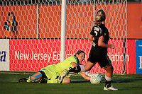 Sky Blue FC goalkeeper Jenni Branam (23) makes a save on McCall Zerboni (7) of the Western New York Flash. The Western New York Flash defeated Sky Blue FC 4-1 during a Women's Professional Soccer (WPS) match at Yurcak Field in Piscataway, NJ, on July 30, 2011.