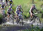 Andy MacDonald (268), Henry Jaine (219) and Ed Kerly (242) cross the first ford. Mammoth Adventure MTB Ride, Nelson<br /> Photo: Marc Palmano/shuttersport.co.nz