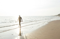 27 JUL 2013 - CROMER, GBR - A competitor walks into the water to warmup ahead of the start of The Anglian Triathlon 2013 at West Runton, North Norfolk, Great Britain (PHOTO COPYRIGHT © 2013 NIGEL FARROW, ALL RIGHTS RESERVED)