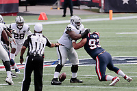 27th September 2020, Foxborough, New England, USA;  New England Patriots defensive lineman Lawrence Guy (93) goes for the fumble with Las Vegas Raiders guard Gabe Jackson (66) unaware during the game between the New England Patriots and the Las Vegas Raiders