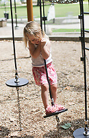 Amelia Cracraft, 3, of Rogers works on her balance, Sunday, July 18, 2021 at the playground at Lake Atalanta. Check out nwaonline.com/210719Daily/ for today's photo gallery. <br /> (NWA Democrat-Gazette/Charlie Kaijo)