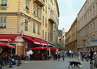 Street scene of  the Old Town of Nice, France.  Shops, restaurants, tourists