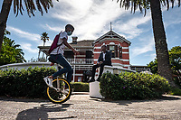 A student rides a unicycle outside the Cape Town College of Magic, which is housed in a historic Victorian building in the Claremont neighbourhood of the city.