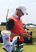13th July 2021; The Royal St. George's Golf Club, Sandwich, Kent, England; The 149th Open Golf Championship, practice day; Rory McIlroy (NIR) studies the course yardage book at the 9th tee