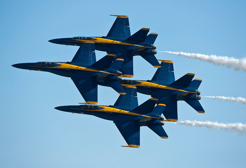 """121014-N-DR144-780 SAN DIEGO (October 14, 2012)- F/A-18C Hornets assigned to the U.S. Navy flight demonstration squadron, the Blue Angels, perform during the Marine Corps Air Station Miramar 2012 Air Show. The air show, held October 12-14, was themed """"Marines In Flight: Celebrating 50 Years of Space Exploration."""" (U.S. Navy photo by Mass Communication Specialist 1st Class James R. Evans / RELEASED)"""