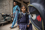 8 November 2013, Govindpuri, Delhi , INDIA:  Farha Khan 7, on her way home from school to the tiny one room family home in Govindpuri she shares with her parents and sister Farhana. Many girls face a variety of hurdles to receiving an education in India that range from ease of access to schools, traditional beliefs in the community, sexual abuse and poverty. Picture by Graham Crouch/ Good Weekend