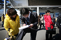 CHINA. Beijing. In mid-February, over 40,000 people crammed the China International Exhibition Centre, all hoping to land a job in a market that is shrinking rapidly in terms of opportunities. Mass unemployment across China as a result of the recent economic crisis in Asia is causing worry for university graduates and migrant workers alike who are finding it increasingly difficult to find any form of work.  2009