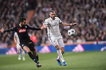 Karim Benzema of Real Madrid (in white) fights for the ball with Raul Albiol of SSC Napoli (in black) Real Madrid vs Napoli, part of the 2016-17 UEFA Champions League Round of 16 at the Santiago Bernabeu Stadium on 15 February 2017 in Madrid, Spain. Photo by Diego Gonzalez Souto / Power Sport Images