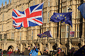 Pro and anti Brexit protesters demonstrate outside the Houses of Parliament on the day Conservative MPs launched a challenge to Theresa May's leadership of the party, Westminster, London.