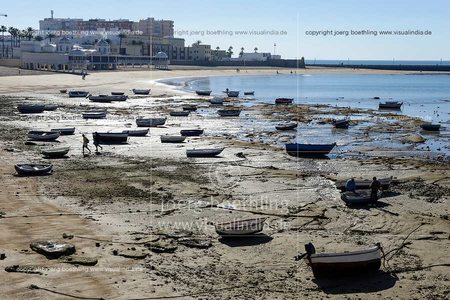 SPAIN, Cardiz, sea bath and beach, fishing boats at shore during low tide