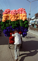 A young man transports yarn by rickshaw along the Grand Trunk Road in Ludhiana, which claims to be the centre of India's textile industry.
