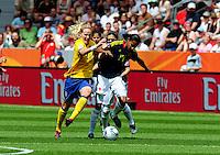 Fifa Women's World Cup Germany 2011 : Colombia - Sweden at Bayarena Leverkusen : Lisa Dahlkvist in duel met Kelis Peduzine..foto DAVID CATRY / Vrouwenteam.be