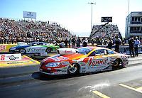 Sept. 25, 2011; Ennis, TX, USA: NHRA pro stock driver Jason Line (near lane) races alongside Steve Kent during the Fall Nationals at the Texas Motorplex. Mandatory Credit: Mark J. Rebilas-