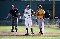 Luke Rasmussen (44) of the Long Beach State Dirtbags is held on first base by David Greer (28) of the Arizona State Sun Devils during a game at Blair Field on February 27, 2016 in Long Beach, California. Long Beach State defeated Arizona State, 5-2. (Larry Goren/Four Seam Images)