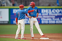 Clearwater Threshers Alec Bohm (40) talks with manager Marty Malloy (2) during a Florida State League game against the Lakeland Flying Tigers on May 14, 2019 at Spectrum Field in Clearwater, Florida.  Clearwater defeated Lakeland 6-3.  (Mike Janes/Four Seam Images)
