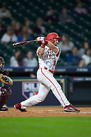 Daniel Lahare (26) of the Louisiana Ragin' Cajuns follows through on his swing against the Mississippi State Bulldogs in game three of the 2018 Shriners Hospitals for Children College Classic at Minute Maid Park on March 2, 2018 in Houston, Texas.  The Bulldogs defeated the Ragin' Cajuns 3-1.   (Brian Westerholt/Four Seam Images)