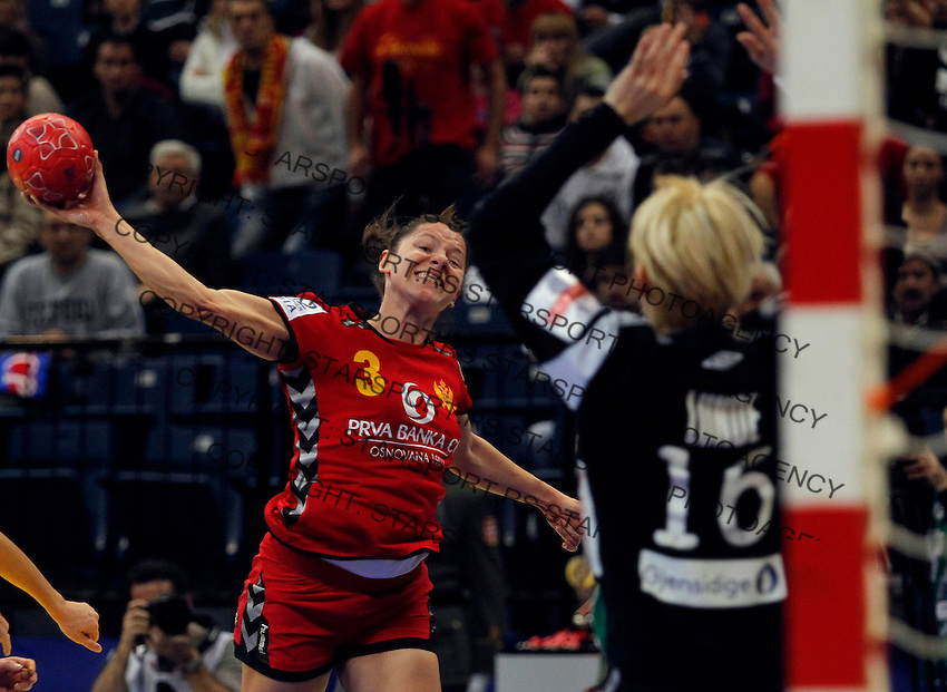 BELGRADE, SERBIA - DECEMBER 16: Biljana Pavicevic of Montenegro (L) jump to scores near goalkeeper Katrine Lunde Haraldsen (R) of Norway during the Women's European Handball Championship 2012 gold medal match between Norway and Montenegro at Arena Hall on December 16, 2012 in Belgrade, Serbia. (Photo by Srdjan Stevanovic/Getty Images)