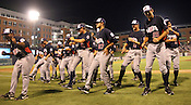 """Team USA players do the """"Cupid's Shuffle"""" after winning Game 3 of the annual Collegiate Friendship Series between Team USA and Japan on Tuesday, July 5, 2011. Photo by Al Drago."""