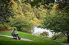 October 12, 2021; Senior Daniel Timofeev studies on a bench at St. Joseph Lake.  (Photo by Barbara Johnston/University of Notre Dame)