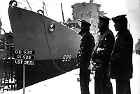 Negro sailors of the USS MASON commissioned at Boston Navy Yard 20 March 1944 proudly look over their ship which is first to have predominantly Negro crew.  (Navy)<br /> NARA FILE #:  080-G-218861<br /> WAR & CONFLICT BOOK #:  935