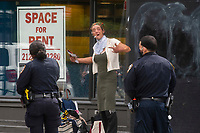 NEW YORK, NY - JUNE 1 : A transgender argues with NYPD officers on a local street on June 1, 2021. in New York City. New York City's Pride events organizers banned police and other law enforcement from marching during annual parade until 2025. (Photo by Eduardo MunozAlvarez/VIEWpress)