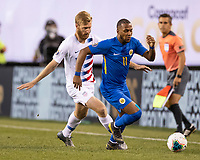 PHILADELPHIA, PA - JUNE 30: Gevaro Nepomuceno #11 dribbles the ball with Tim Ream #13 in pursuit during a game between Curaçao and USMNT at Lincoln Financial Field on June 30, 2019 in Philadelphia, Pennsylvania.