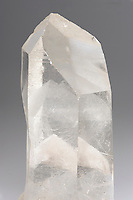 Quartz crystal with double phantoms. Brazil. A phantom is a quartz crystal which grows over an earlier crystal, usually due to a change in growth conditions causing a stoppage or interruption. The  orginal crystal may have had deposition of fine-grained mineral matter, micro-bubbles, or even rock dust collect on its face during the interruptive period. Such inclusions further highlight the phantom.