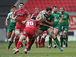 Connacht's Jake Heenan is tackled by Scarlets' Jordan Williams<br /> <br /> Rugby - Scarlets V Connacht - Guinness Pro12 - Sunday 15th Febuary 2015 - Parc-y-Scarlets - Llanelli<br /> <br /> © www.sportingwales.com- PLEASE CREDIT IAN COOK