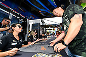 #57 Heinricher Racing w/Meyer Shank Racing Acura NSX GT3, GTD: Katherine Legge, Alice Powell signs an autograph for fan