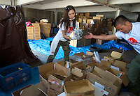 OGA for Aid prepare food to be distributed in the  Minamisanriku area, Myiagi, Japan. The fishing port of Minamisanriku's popultion was reduced from 18,000 to about 8,000 when 10,0000 where washed out to sea and many people are living in shelters relying on volunteer Aid for food and water.<br /> <br /> Photo by Richard Jones/ Sinopix