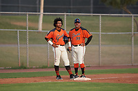 AZL Giants Orange Luis Toribio (22) talks to manager Alvaro Espinoza (99) during an Arizona League game against the AZL Mariners on July 18, 2019 at the Giants Baseball Complex in Scottsdale, Arizona. The AZL Giants Orange defeated the AZL Mariners 7-4. (Zachary Lucy/Four Seam Images)