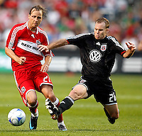 DC United defender Bryan Namoff (26) slide tackles the ball away from Chicago Fire midfielder Justin Mapp (21).  The DC United defeated the Chicago Fire 2-1 at Toyota Park in Bridgeview, IL on June 7, 2008.