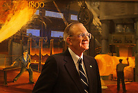 """STEEL:  Bethlehem Steel former CEO  C. """"Hank"""" Barnette stands in front of a painting depicting Bessemer steel making at the 1st forge of Bethlehem Steel  back in the 1890's     ( CHUCK ZOVKO/  TMC)"""