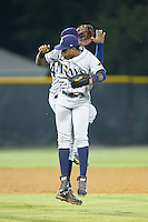 Manny Sanchez (13) of the Princeton Rays celebrates with teamnate Nic Wilson (44) after their victory over the Burlington Royals at Burlington Athletic Park on July 9, 2014 in Burlington, North Carolina.  The Rays defeated the Royals 3-0.  (Brian Westerholt/Four Seam Images)