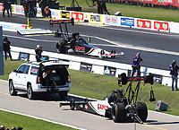 Apr 14, 2019; Baytown, TX, USA; The dragster of NHRA top fuel driver Steve Torrence (near) is towed to pits as father Billy Torrence races during the Springnationals at Houston Raceway Park. Mandatory Credit: Mark J. Rebilas-USA TODAY Sports