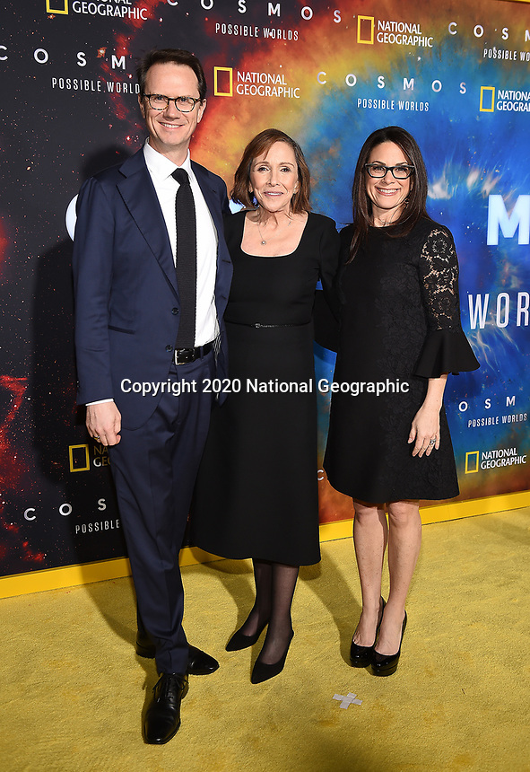 """LOS ANGELES - FEBRUARY 26: (L-R) Chairman, Walt Disney Television and Co-Chair, Disney Media Networks Peter Rice, National Geographic Global Television Networks President Courteney Monroe, and writer and director Ann Druyan attend National Geographic's 2020 Los Angeles premiere of """"Cosmos: Possible Worlds"""" at Royce Hall on February 26, 2020 in Los Angeles, California. Cosmos: Possible Worlds premieres Monday, March 9 at 8/7c on National Geographic. (Photo by Frank Micelotta/National Geographic/PictureGroup)"""