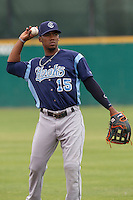 Corpus Christi Hooks outfielder Teoscar Hernandez (15) warms up before the Texas League baseball game against the San Antonio Missions on May 10, 2015 at Nelson Wolff Stadium in San Antonio, Texas. The Missions defeated the Hooks 6-5. (Andrew Woolley/Four Seam Images)