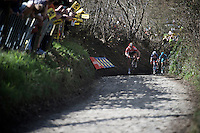 André Greipel (DEU/Lotto-Soudal) is the first rider to appear up on the infamous Koppenberg<br /> <br /> 100th Ronde van Vlaanderen 2016
