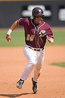 Tony Sanchez #26 of the Boston College Eagles hustles towards third base versus the Wake Forest Demon Deacons at Wake Forest Baseball Park April 11, 2009 in Winston-Salem, NC. (Photo by Brian Westerholt / Four Seam Images)