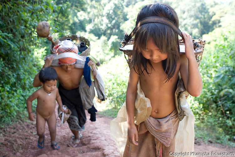 An Akha family carry water up hill at a village in Luang Namtha, Laos on November 9, 2009.   (Photo by Khampha Bouaphanh)