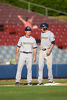 Trenton Thunder manager Bobby Mitchell (left) talks with Tyler Wade (right) during the first game of a doubleheader against the Hartford Yard Goats on June 1, 2016 at Sen. Thomas J. Dodd Memorial Stadium in Norwich, Connecticut.  Trenton defeated Hartford 4-2.  (Mike Janes/Four Seam Images)