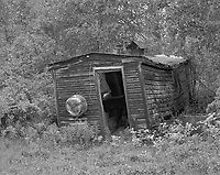 """""""Miners Cabin at F.E. Gold Camp"""" <br /> Chatanika, Alaska<br /> <br /> A gold camp of The Fairbanks Exploration Company is located just north of Fairbanks on the Old Steese Highway. The camp contains thirteen original buildings dating as far back as 1925 and is listed on the National Register of Historic Places. This black and white photo shows a miner's cabin at the camp."""