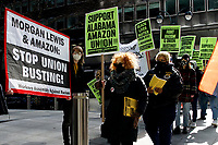 NEW YORK, NEW YORK - MARCH 04: People walk holding a placards during a protest to support Amazon workers in Alabama on March 04, 2021 in New York. Amazon is the second largest employer in the United States - with 400,000 workers and about 1.3 million employees worldwide. (Photo by Emaz/VIEWpress)
