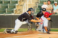 Wander Ramos (26) of the Hagerstown Suns slides across home plate ahead of the tag by Zachary Fisher (13) of the Kannapolis Intimidators as home plate umpire Jorge Teran looks on at CMC-Northeast Stadium on May 17, 2013 in Kannapolis, North Carolina.  The Suns defeated the Intimidators 9-7.   (Brian Westerholt/Four Seam Images)