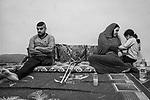 GAZA, Beit Laya: Tarek is sitting with his family in the living room of their house. He used to be a very active young man practicing any kind of sports but nowadays he doesn't go really far from the house, the 31th of October 2019.<br /> <br /> GAZA, Beit Laya: Tarek est assis avec sa soeur et sa mère dans le salon de leur maison. Il était un jeune homme très actif pratiquant tout type de sport, mais depuis son amputation, il ne s'éloigne plus de sa maison, le 31 octobre 2019.