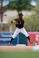 GCL Orioles second baseman Carlos Baez (13) throws to first base during a Gulf Coast League game against the GCL Braves on August 5, 2019 at Ed Smith Stadium in Sarasota, Florida.  GCL Orioles defeated the GCL Braves 4-3 in the second game of a doubleheader.  (Mike Janes/Four Seam Images)