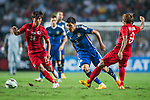 (C) Enzo Perez of Argentina  is followed by (L) Yingzhi of Hong Kong and (R) Wai Lim Lee of Hong Kong during the HKFA Centennial Celebration Match between Hong Kong vs Argentina at the Hong Kong Stadium on 14th October 2014 in Hong Kong, China. Photo by Aitor Alcalde / Power Sport Images