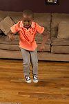 4 year old boy at home full length dancing