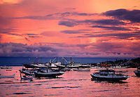 Boats at sunset Donggala Harbor Sulawesi Indonesia.